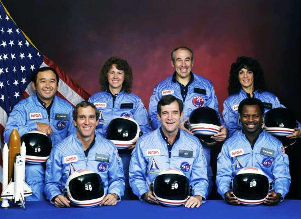 The crew of the Space Shuttle Challenger STS 51-L mission, (L to R -back row) Ellison S Onizuka, Sharon Christa McAuliffe, Gregory B Jarvis, Judith A Resnik, (L to R - front row) Michael J Smith, Francis R Scobee and Ronald E McNair pose in 1985. All seven astronauts onboard the Challenger died 29-years ago on Jan. 28, 1986 when the space shuttle exploded 73 seconds after takeoff.