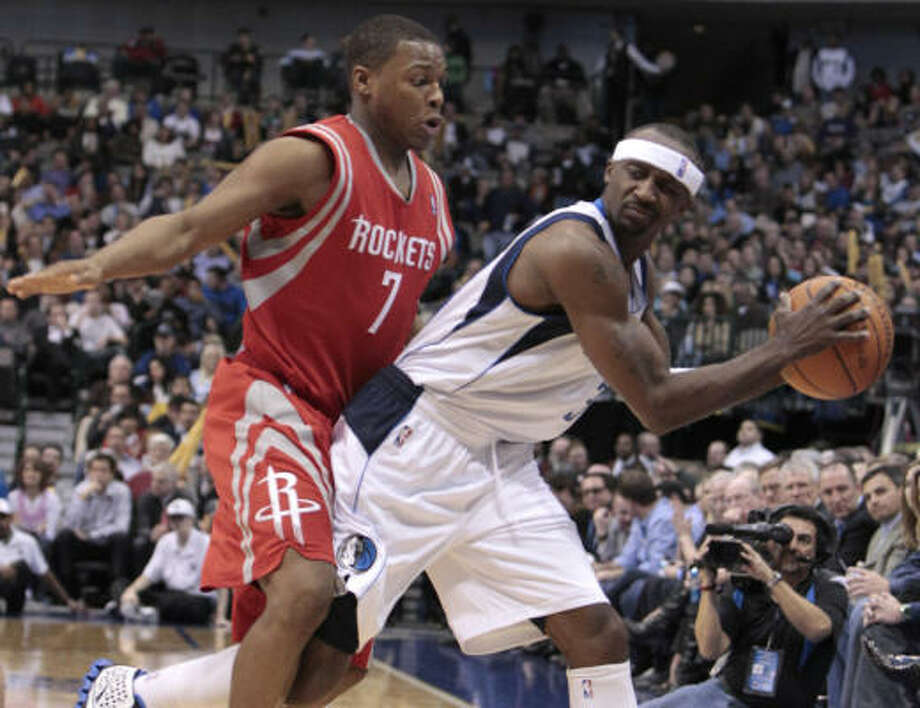 Jan. 27: Mavericks 111, Rockets 106 Rockets guard Kyle Lowry, left, tries to box Mavericks guard Jason Terry into a corner during the first half. Terry scored 15 points off the bench to help the Mavericks survive a furious second-half rally by the Rockets. Photo: LM Otero, AP
