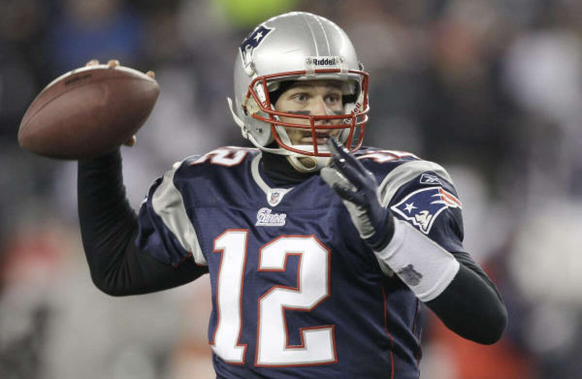 OFFENSE Quarterback: Tom Brady, New England The Patriots' quarterback led the league with a 111.0 passer rating. He threw for 38 touchdowns and just four interceptions during the regular season in guiding his team to a 14-2 record.