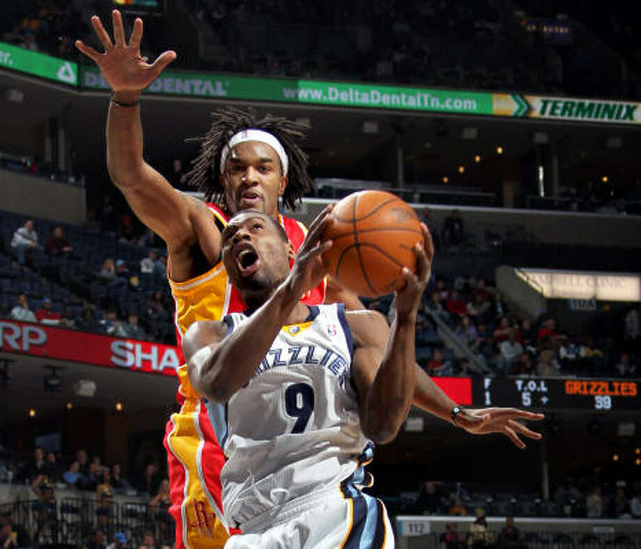 Jan. 21: Grizzlies 115, Rockets 110 Grizzlies guard Tony Allen (9) gets past Rockets forward Jordan Hill for a first-half shot during Friday night's game in Memphis, Tenn. Photo: Nikki Boertman, AP