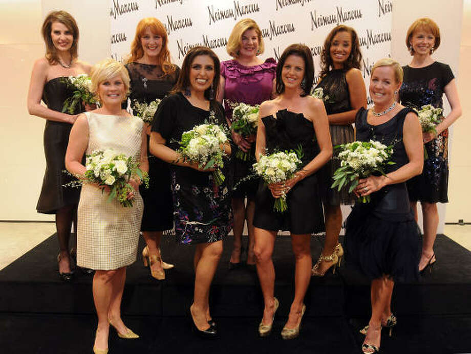 The Houston Chronicle's Best Dressed honorees pose for a photo at the announcement party at Neiman Marcus Wednesday Jan. 19, 2011. Front row from left: Kelli Blanton, Nidhika Mehta, Elizabeth Petersen and Rosemary Schatzman. Back row from left: Carmen Maria Montiel-Lechin, Gracie Cavnar, Julia Anderson-Frankel, Arvia Few and Susan Krohn. Not pictured is Sheridan Williams. More about the event. Photo: Dave Rossman, For The Chronicle