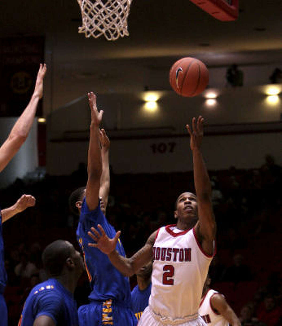 UH guard Zamal Nixon (2) drives to the basket during the second half. He led the Cougars with 14 points.