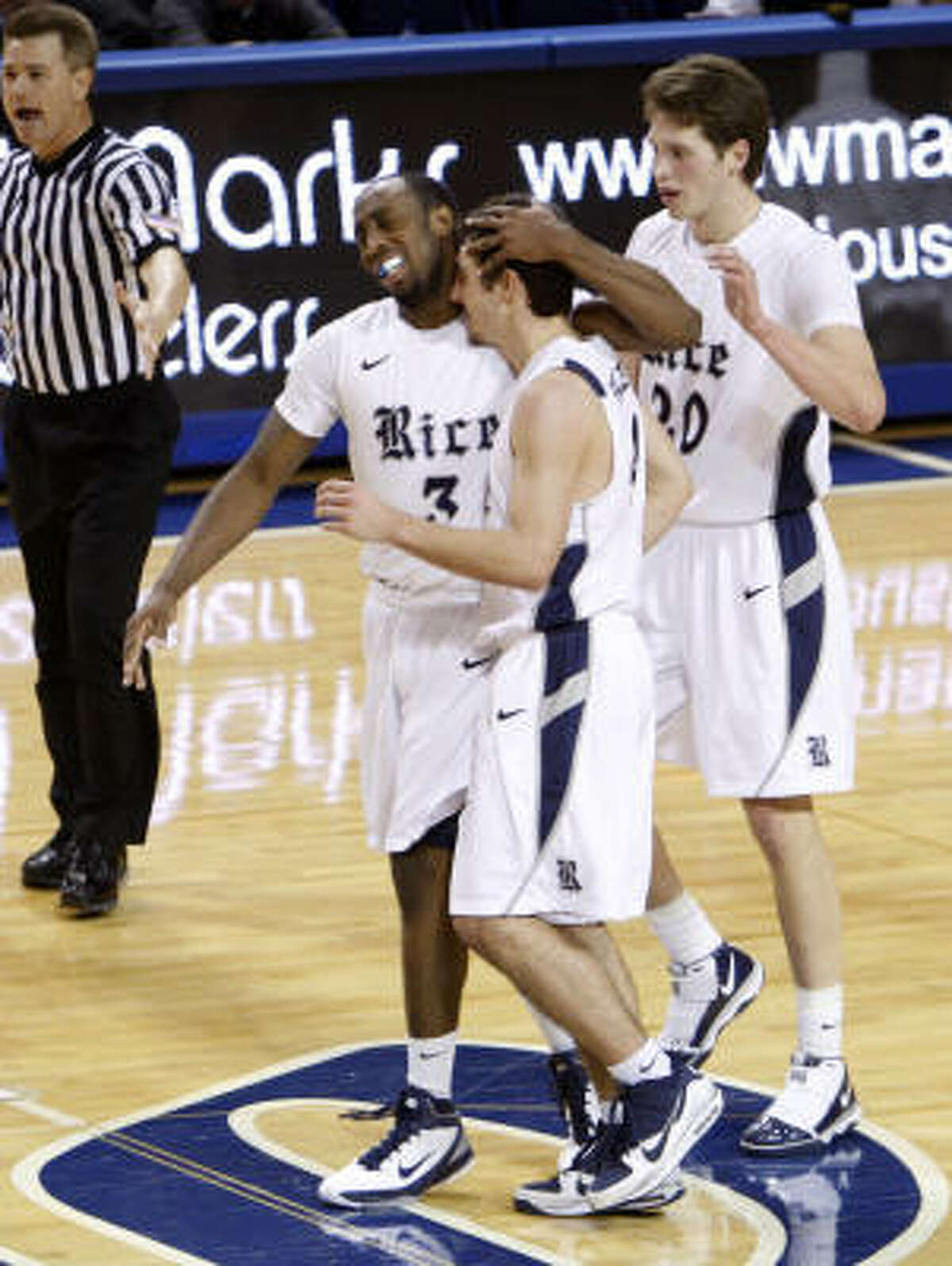 Rice's Connor Frizzelle, right, is congratulated by Tamir Jackson (3) after hitting a 3-pointer at the end of regulation to send the game into overtime.