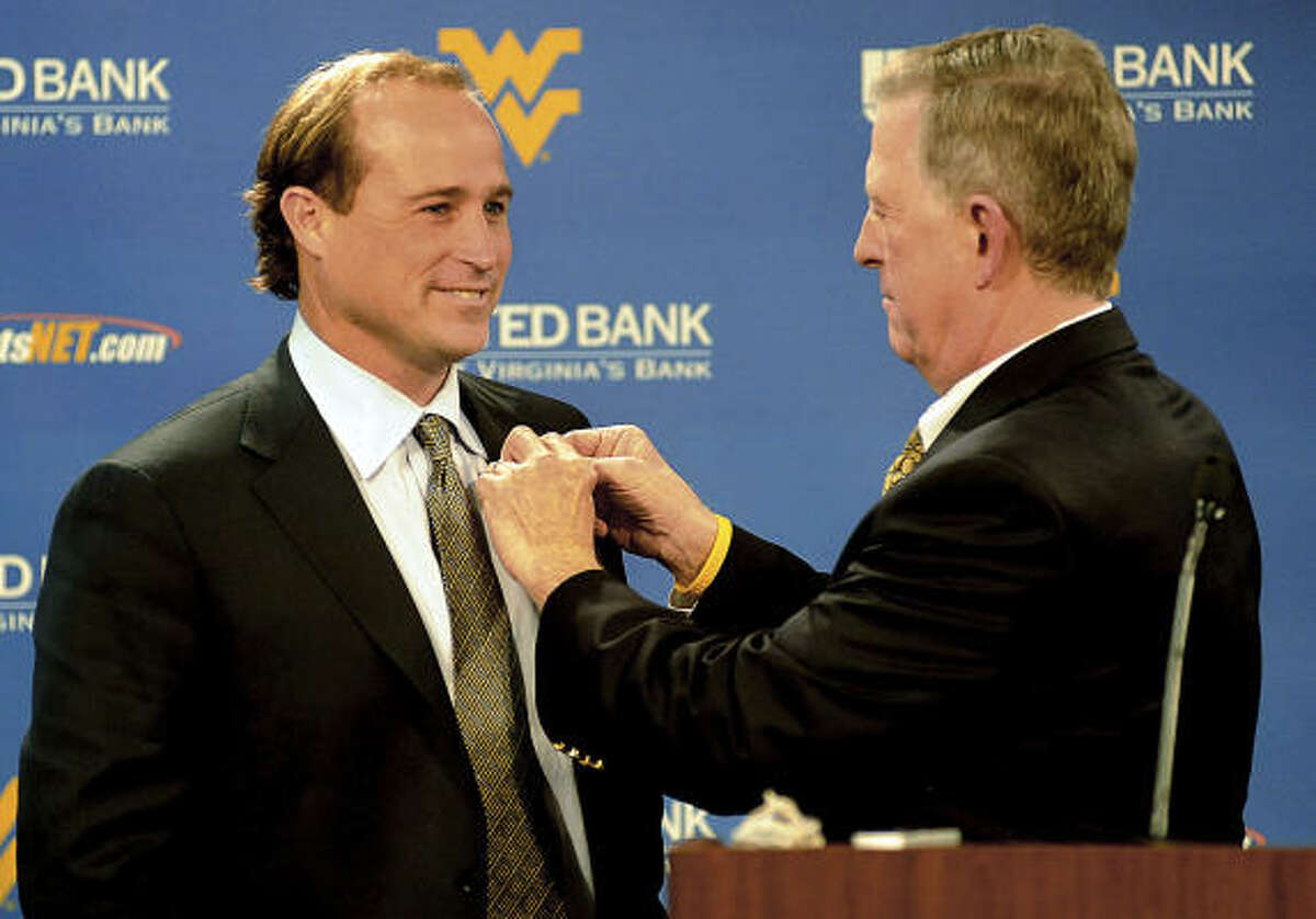 School: West Virginia Who's out: Bill Stewart after 2011 season Who's in: Dana Holgorsen Holgorsen, a former offensive coordinator at UH and Oklahoma State, will serve as the Moutaineers' offensive coordinator and head coach in waiting for the 2011 season. He will replace Stewart for the 2012 season.