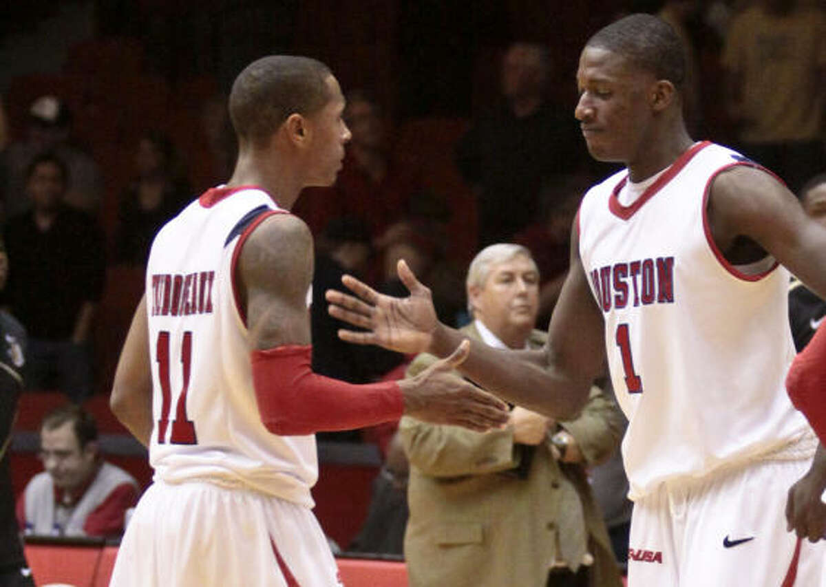 Houston players Darian Thibodeaux (11), left, and Mikhail McLean (1) celebrate their win against Central Florida.