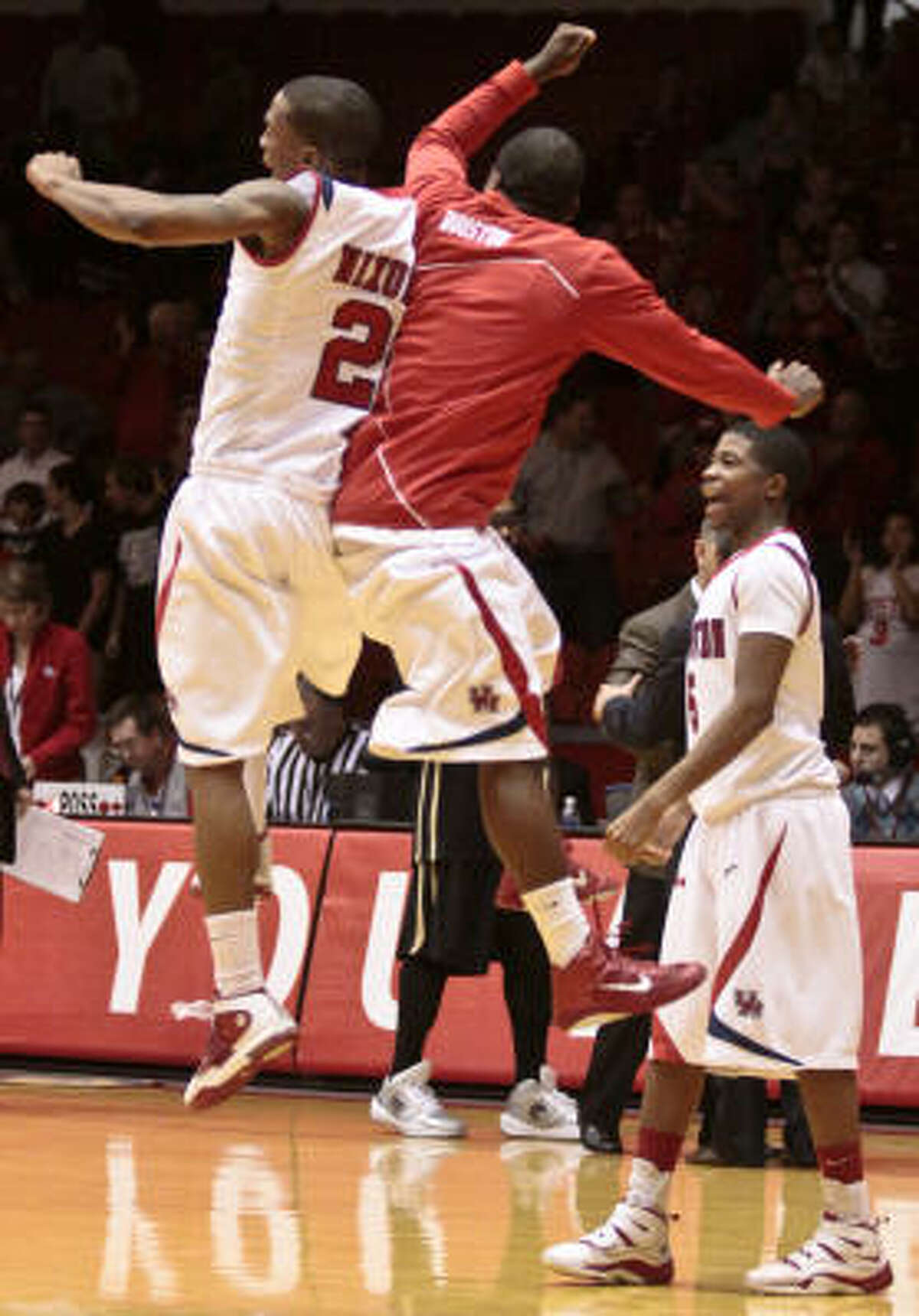 UH players celebrate their victory against Central Florida.