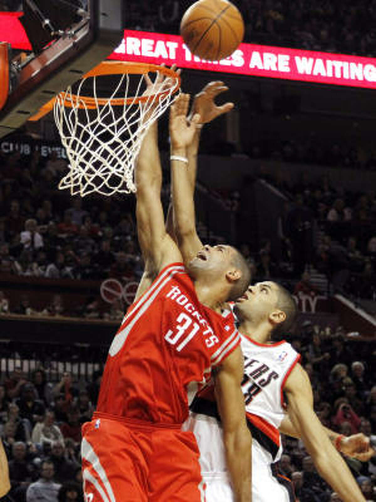 Rockets forward Shane Battier, left, fights for a rebound with Trail Blazers forward Nicolas Batum.