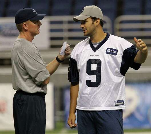 Head coach Jason Garrett (left) and quarterback Tony Romo discuss a play during the morning session of the Dallas Cowboys training camp at the Alamodome on Friday, July 29, 2011. Kin Man Hui/kmhui@express-news.net Photo: KIN MAN HUI, : / SAN ANTONIO EXPRESS-NEWS