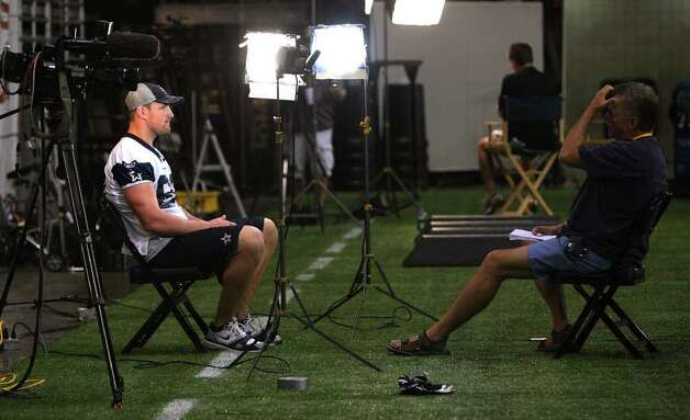 Tight end Jason Witten (left) sits down for a television interview after the morning session of the Dallas Cowboys training camp at the Alamodome on Friday, July 29, 2011. Kin Man Hui/kmhui@express-news.net Photo: KIN MAN HUI, : / SAN ANTONIO EXPRESS-NEWS
