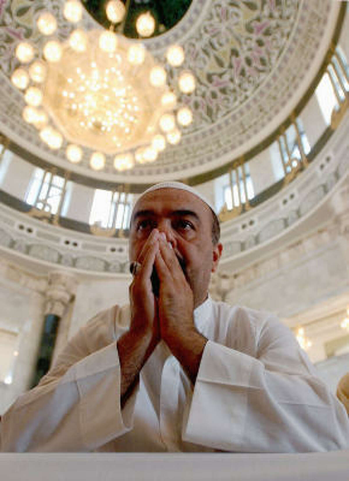 A Sunni Muslim says Friday noon prayers in a Baghdad mosque. All Muslims, whether Shia or Sunni, follow Islam's five basic tenets. The most basic is the belief in one God, known as Allah, and in Muhammad as his prophet.
