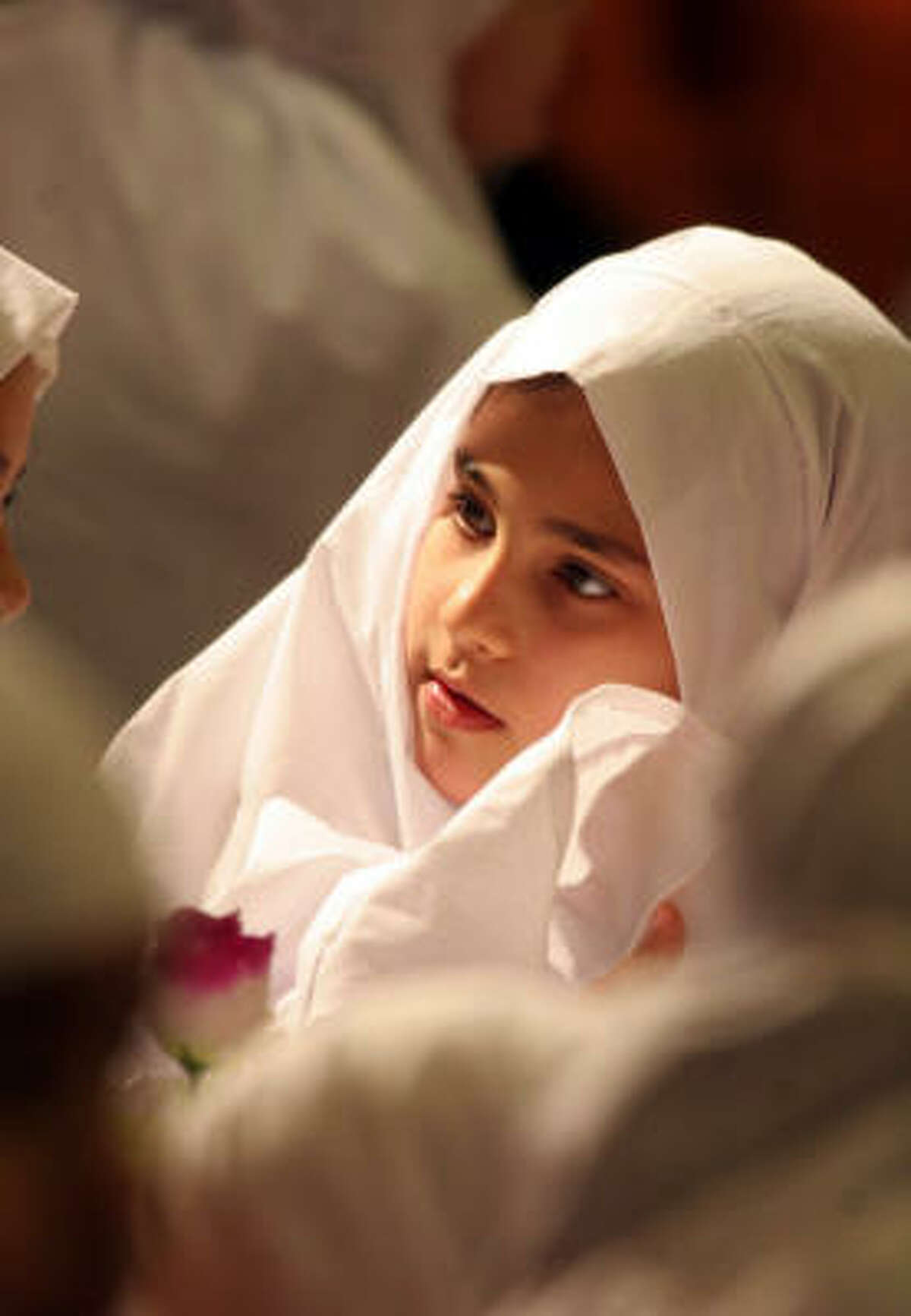 A 9-year-old Shia girl in the holy city of Karbala, Iraq, takes part in a ceremony. Although religious differences exist between Sunnis and Shias, the animosity in Iraq, observers say, is rooted less in religion than in politics and history.