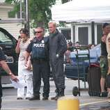 """Ryan Gosling poses with a police officer during a break in filming of """"The Place Beyond the Pines"""" on Friday, July 29. The day's filming was being carried out outside the First National Bank of Scotia branch in Scotia. (Desiree LaBombard / Special to the Times Union)"""