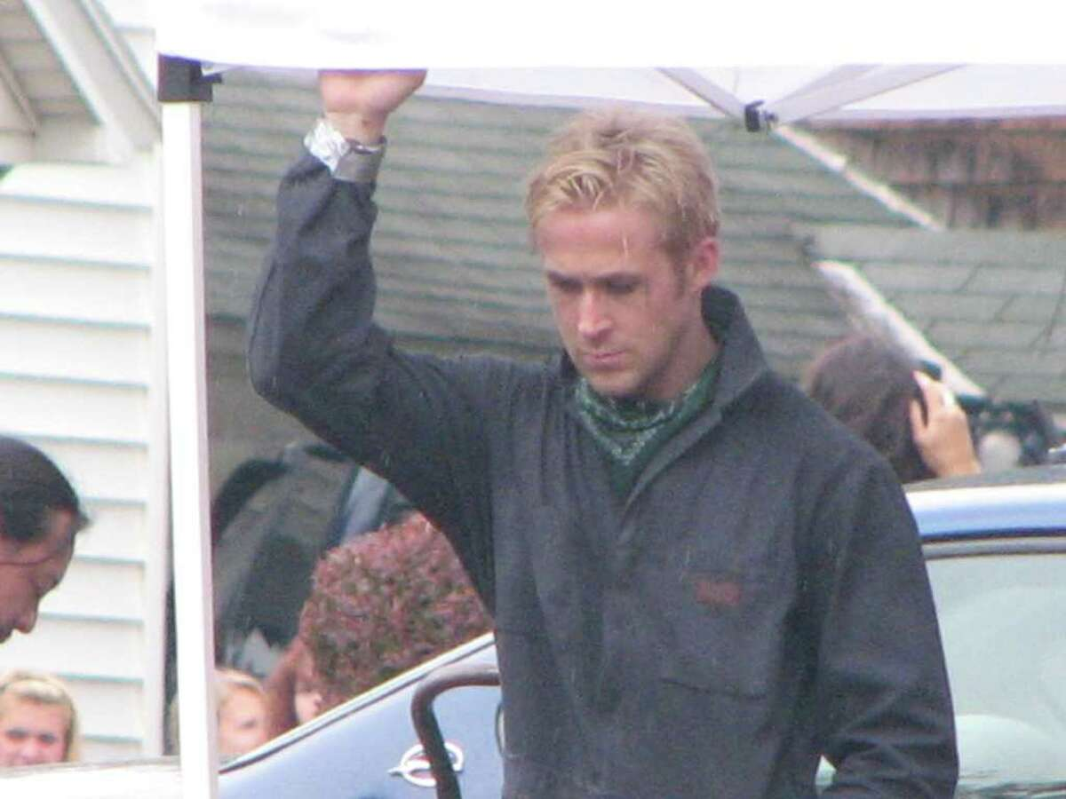 """Ryan Gosling during a break in filming of """"The Place Beyond the Pines"""" on Friday, July 29. The day's filming was being carried out outside the First National Bank of Scotia branch in Scotia. (Desiree LaBombard / Special to the Times Union)"""
