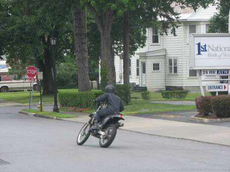 "Ryan Gosling rides a motorcycle during  filming of ""The Place Beyond the Pines"" on Friday, July 29. The day's filming was being carried out outside the First National Bank of Scotia branch in Scotia. (Desiree LaBombard / Special to the Times Union)"
