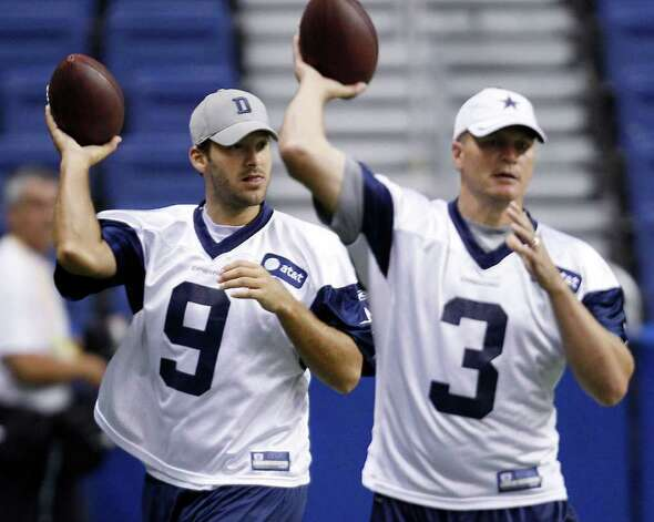 Dallas Cowboys quarterback Tony Romo (9) and Jon Kitna (3) take part in a drill during NFL football training camp, Friday, July 29, 2011, in San Antonio. Photo: AP