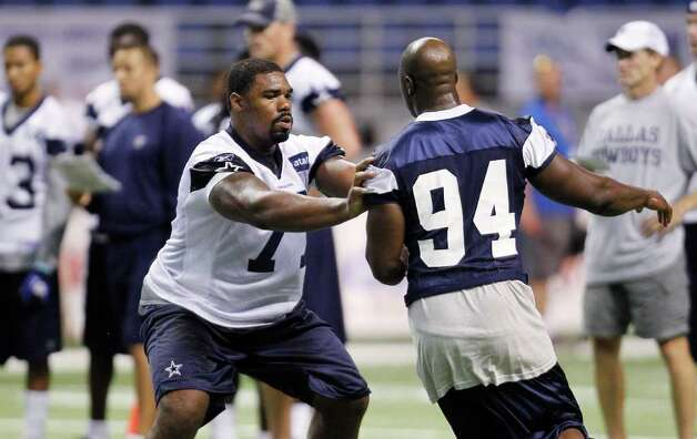 Dallas Cowboys' Tyron Smith, left, and DeMarcus Ware take part in a drill during NFL football training camp, Friday, July 29, 2011, in San Antonio. Photo: AP