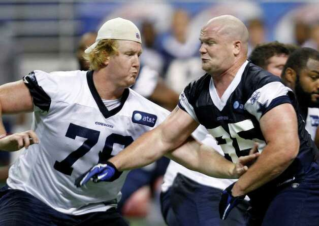 Dallas Cowboys' Sam Young, left, and  Sean Lissemore, right, take part in a drill during NFL football training camp, Friday, July 29, 2011, in San Antonio. Photo: AP