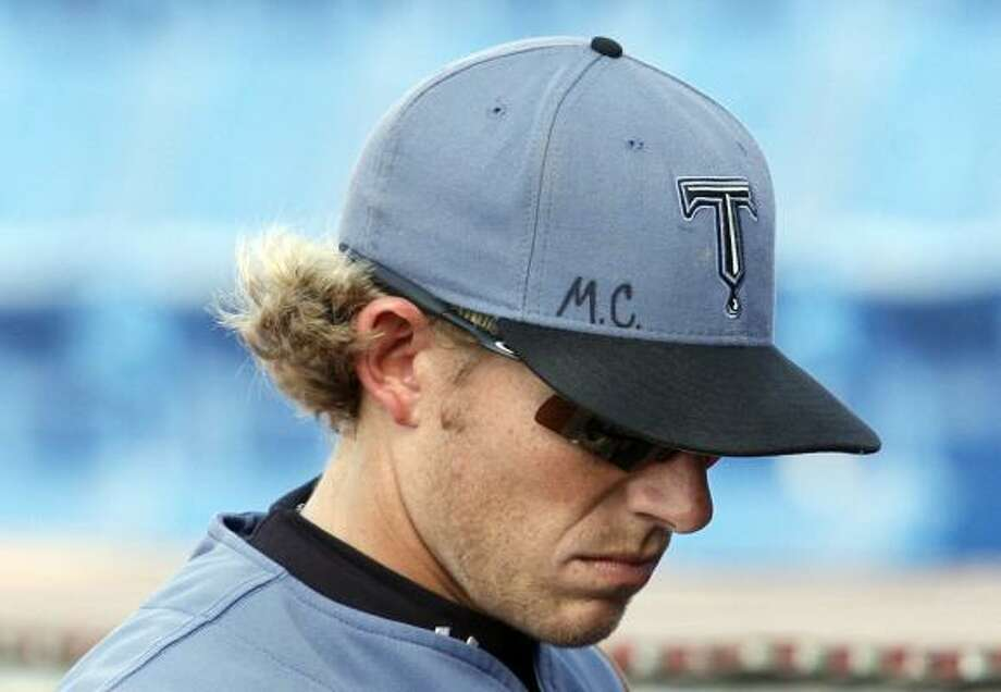 Tulsa Drillers player Chris Frey remembers Mike Coolbaugh with Coolbaugh's initials on his cap at Tuesday's game at Wichita, Kan. Photo: G. Marc Benavidez, AP