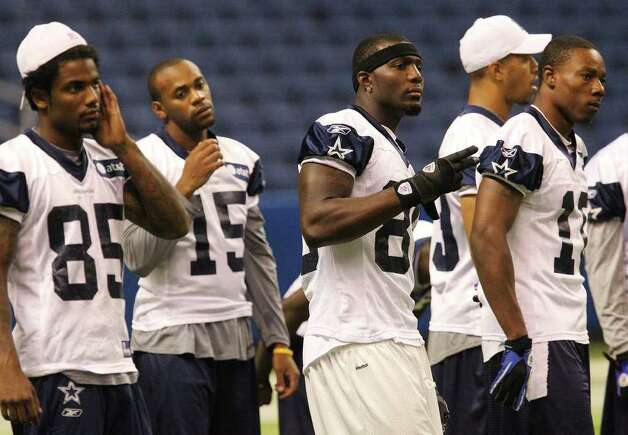 Receiver Dez Bryant (third from left) joins fellow receivers for practice during the morning session of the Dallas Cowboys training camp at the Alamodome on Friday, July 29, 2011. Kin Man Hui/kmhui@express-news.net Photo: KIN MAN HUI, SAN ANTONIO EXPRESS-NEWS / SAN ANTONIO EXPRESS-NEWS