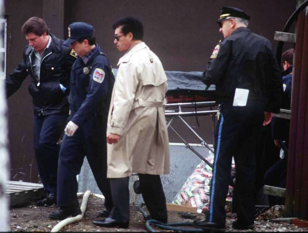 Danbury police remove Craig Thorndike's body from Pie-Zon's pizza resturant where he was killed. Photo originally published 1/17/89. The News-Times/ Bob East