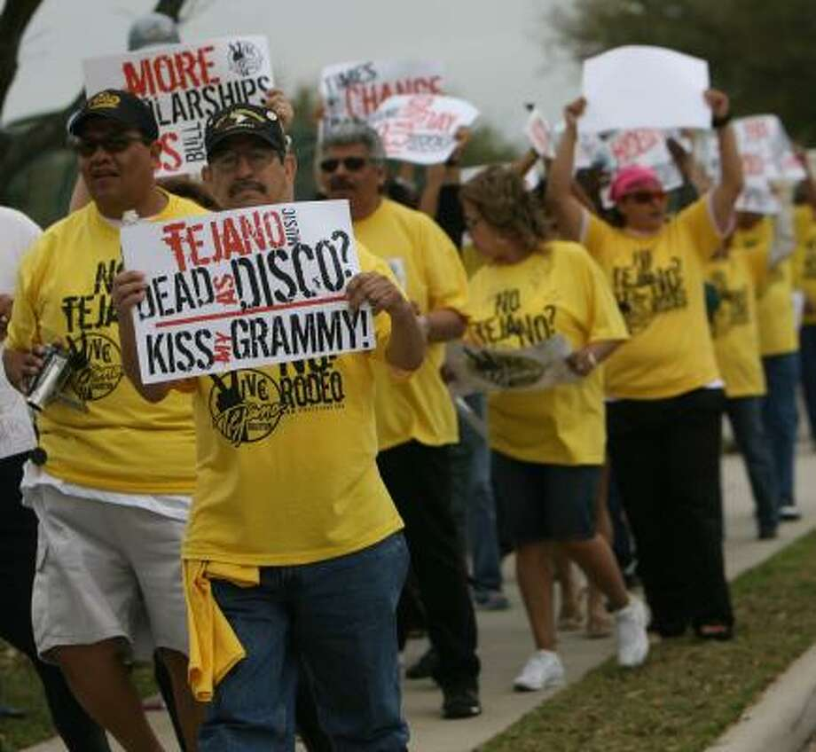 Demonstrators organized by VIVE Tejano-Houston protest against the rodeo's Go Tejano Day in front of Reliant Center in 2008. Local Hispanic leaders are upset that RodeoHouston didn't book a Tejano act. Photo: SHARÓN STEINMANN, CHRONICLE