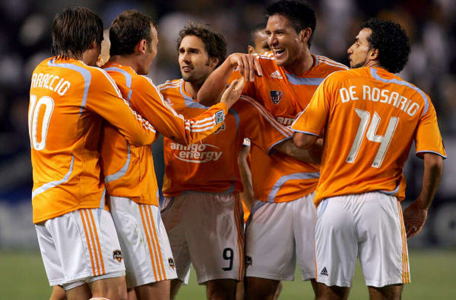 Houston Dynamo players, from the left, Brian Mullan, Brad Davis, Franco Caraccio, Brian Ching and Dwayne De Rosario Photo: Victor Decolongon, Getty Images