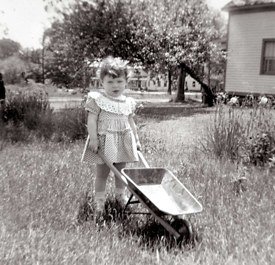 Even as a young tot, Denise loved gardening.