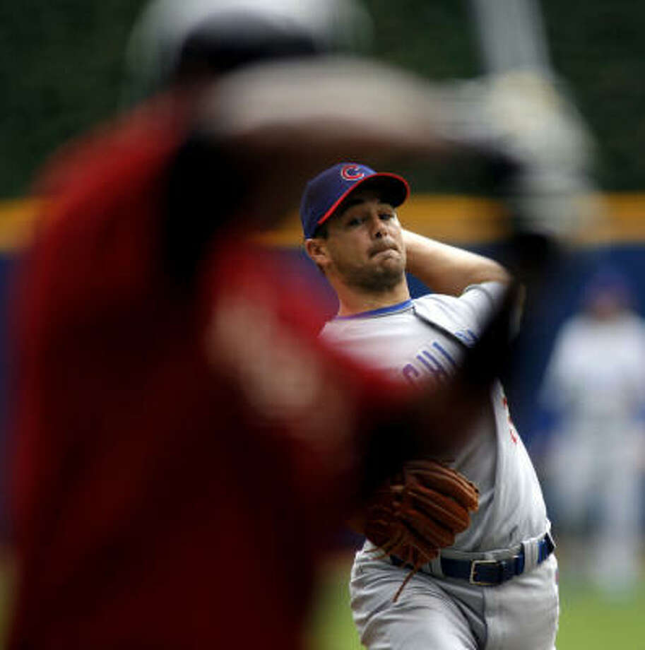 Ted Lilly's win came in one of two games for the displaced Astros. Photo: DARREN HAUCK, AP