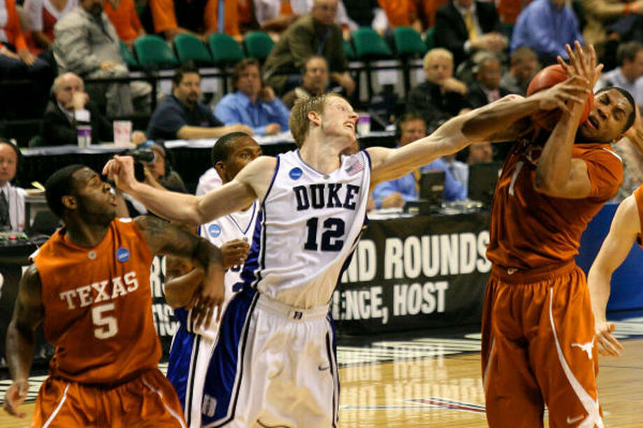 Gary Johnson, right, pulls a rebound away from Duke's Kyle Singler (12) during Saturday's 74-69 loss to the Blue Devils in the East Regional. Photo: Streeter Lecka, Getty Images