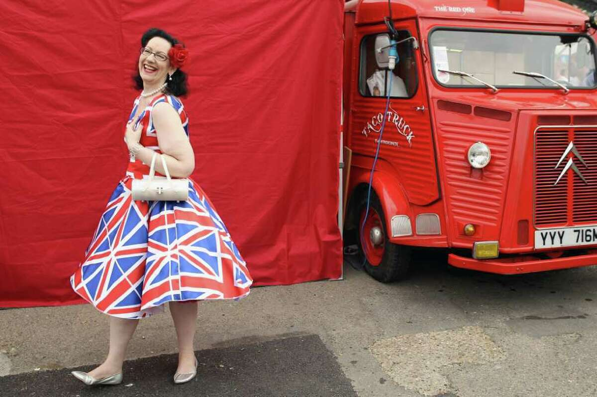 A woman poses for pictures at the Vintage Festival on July 29, 2011 in London.