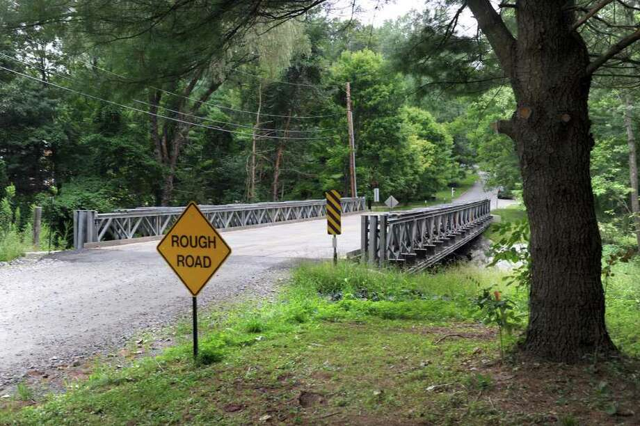 A temporary bridge covers the huge gap in the road that was created when a culvert on Chinmoy Lane in New Milford was washed away by heavy rains in March. Photo taken Friday, July 29, 2011. Photo: Carol Kaliff