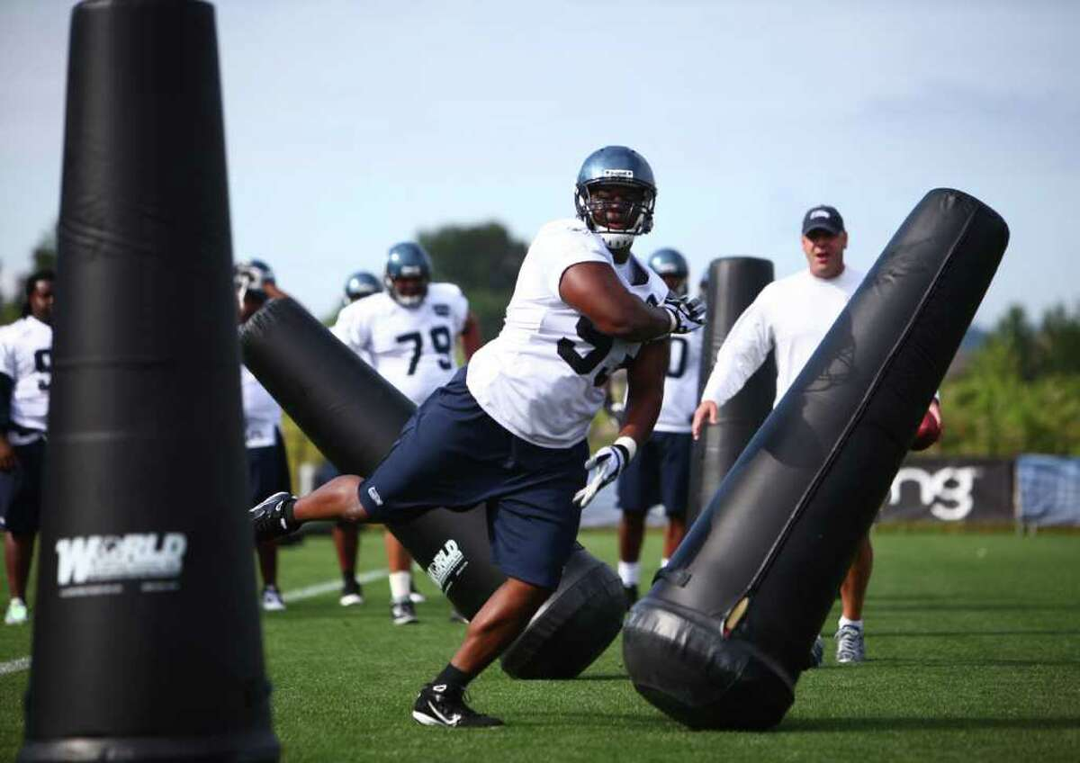 Defensive end Pep Levingston runs a drill during day two of Seattle Seahawks training camp at the VMAC on Friday, July 29, 2011.