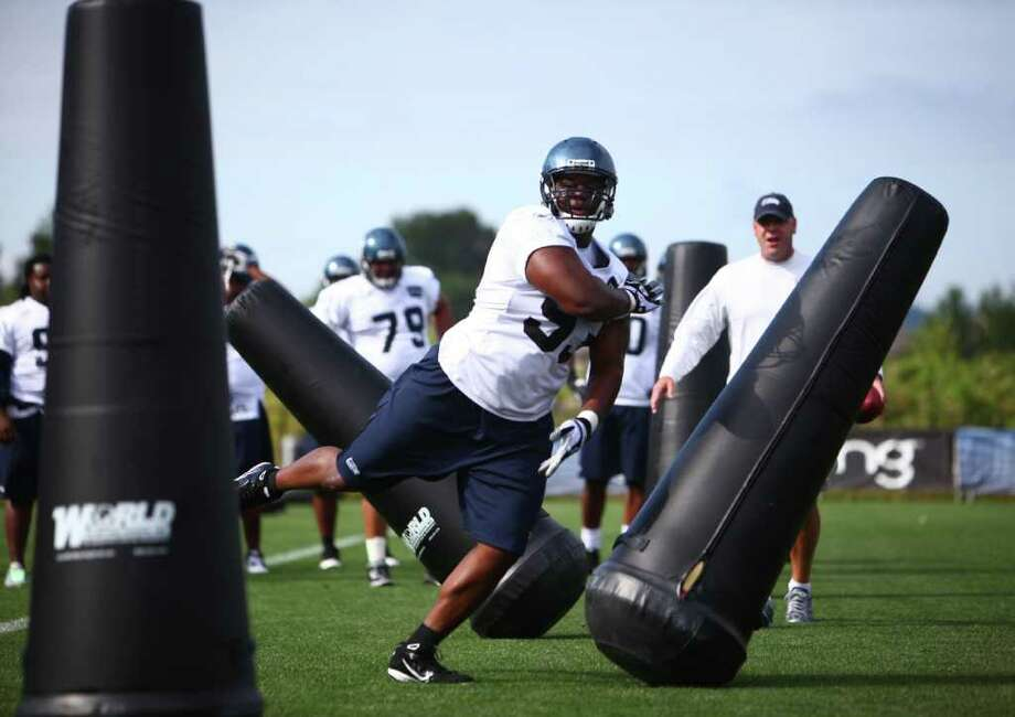 Defensive end Pep Levingston runs a drill during day two of Seattle Seahawks training camp at the VMAC on Friday, July 29, 2011. Photo: JOSHUA TRUJILLO / SEATTLEPI.COM