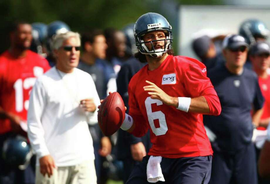 Quarterback Charlie Whitehurst throws during a drill during day two of Seattle Seahawks training camp. Photo: JOSHUA TRUJILLO / SEATTLEPI.COM