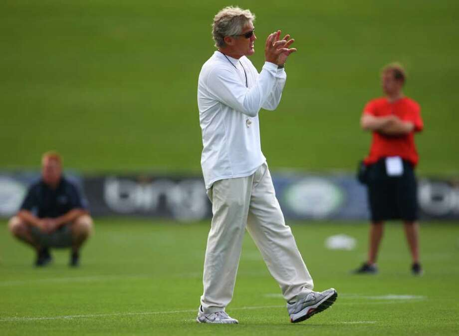 Coach Pete Carroll instructs players during day two of Seattle Seahawks training camp at the VMAC. Photo: JOSHUA TRUJILLO / SEATTLEPI.COM