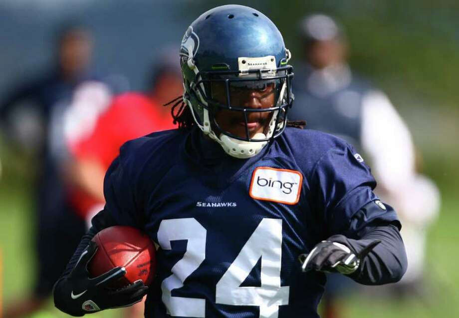 Running back Marshawn Lynch carries the ball during day two of Seattle Seahawks training camp. Photo: JOSHUA TRUJILLO / SEATTLEPI.COM