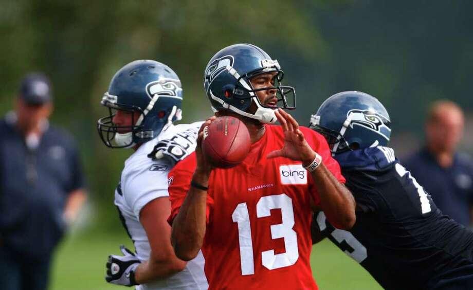 Quarterback Josh Portis prepares to throw. Photo: JOSHUA TRUJILLO / SEATTLEPI.COM