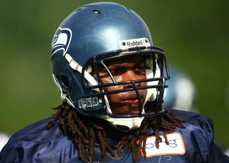 James Carpenter listens to instruction during day two of Seattle Seahawks training camp. Photo: JOSHUA TRUJILLO / SEATTLEPI.COM