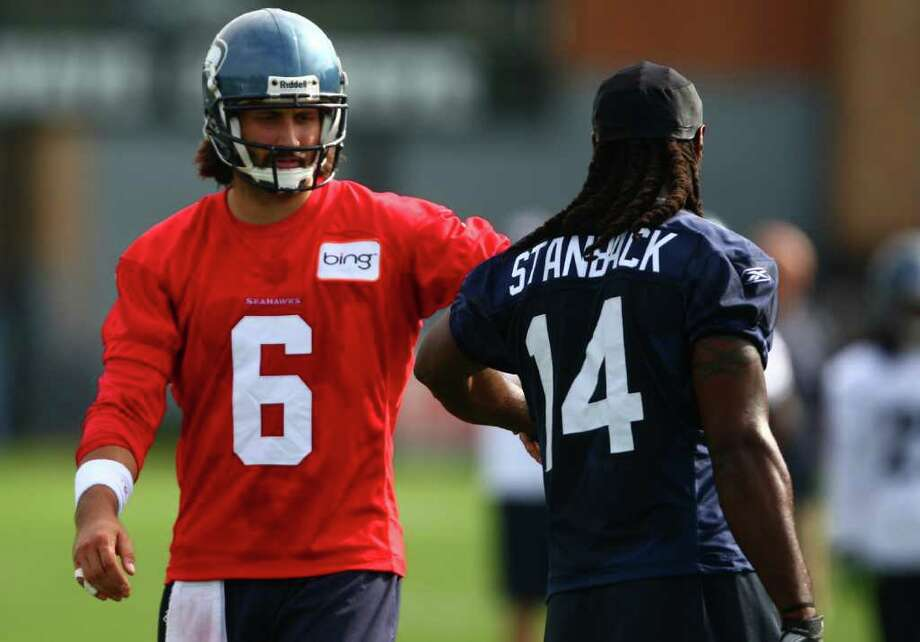 Quarterback Charlie Whitehurst shakes hands with Isaiah Stanback after a drill on day two of Seattle Seahawks training camp. Photo: JOSHUA TRUJILLO / SEATTLEPI.COM
