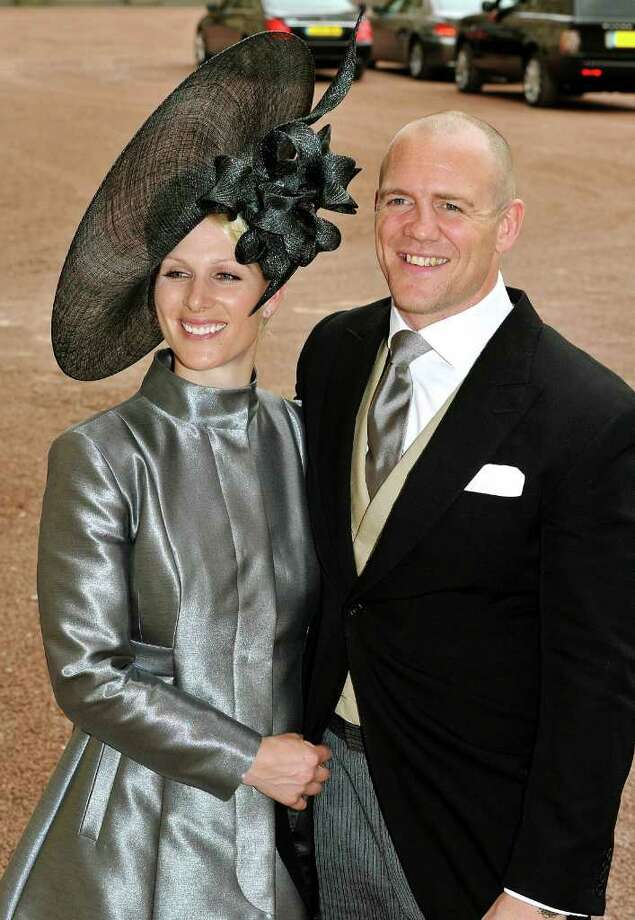 FILE - In this April 29, 2011 file photo, Zara Phillips, left, and her fiance Mike Tindall leave the wedding reception for Britain's Prince William and Catherine Middleton at Buckingham Palace, London. Britain will celebrate its second royal wedding of the season Saturday, July 30, 2011, with equestrian star Zara Phillips - eldest granddaughter of Queen Elizabeth II - set to take center stage as she marries England rugby stalwart Mike Tindall. (AP Photo/John Stillwell, Pool-File) Photo: John Stillwell / POOL PA