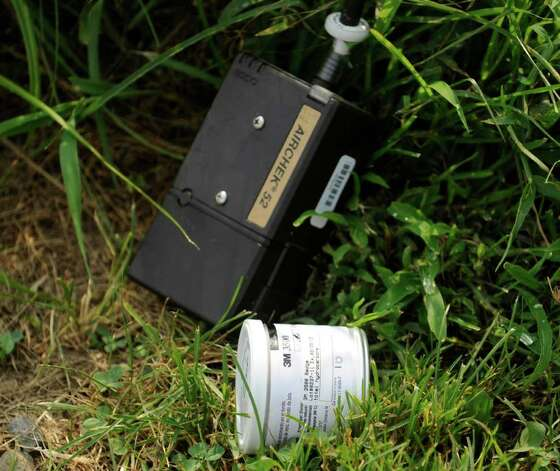 Environmental testing devices in the grass next to the artificial turf field at Greenwich High School, Friday afternoon, July 29, 2011.  School officials announced all Greenwich High School playing fields would be closed immediately Friday after testing discovered PCB toxins that exceed regulatory standards near fields 3 and 4. District officials began testing soil samples after workers on the school's new auditorium project discovered contaminated soil earlier this month. Photo: Bob Luckey