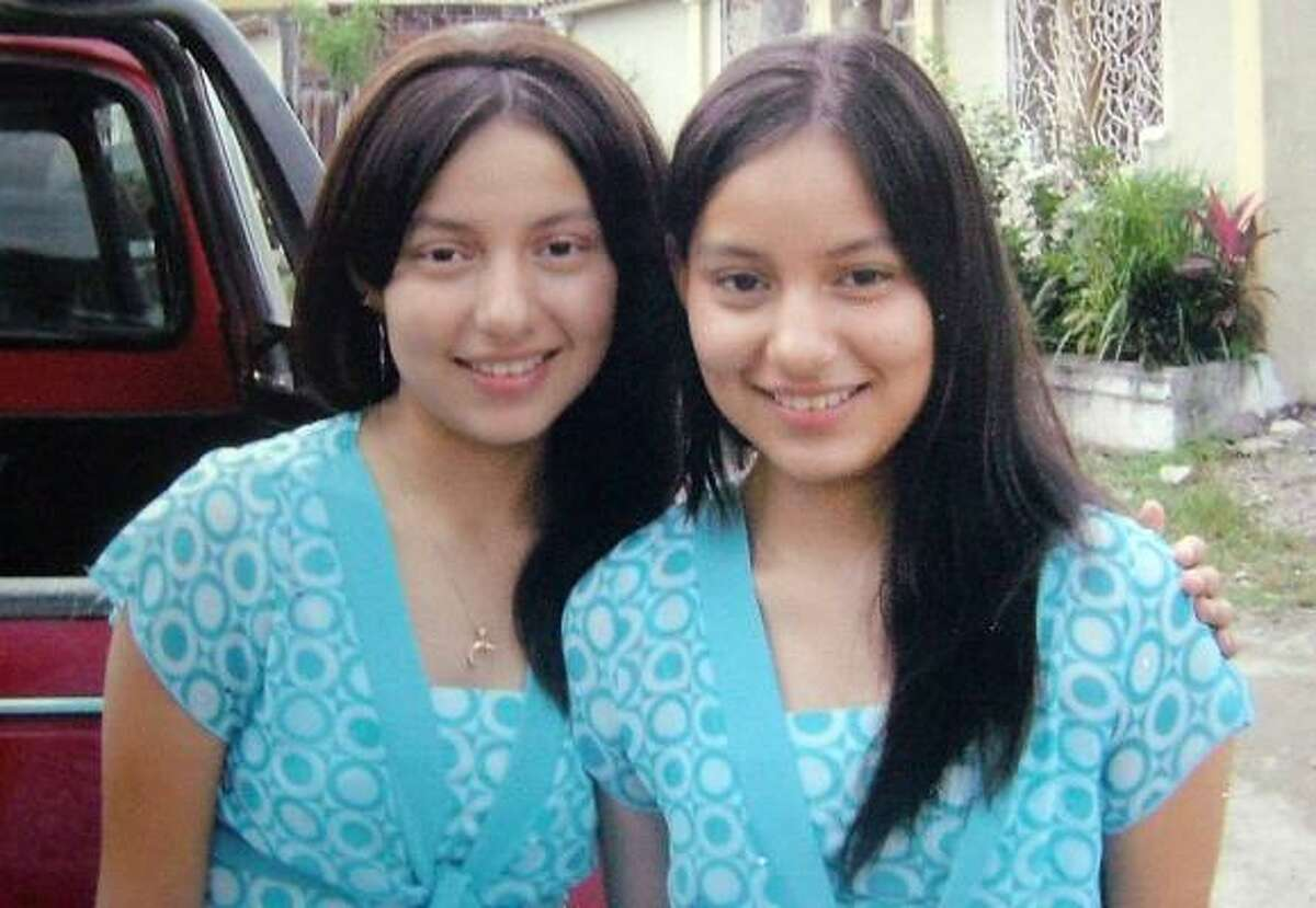 """Identical twins Andrea Freire and Marielisa Romo, unknown who is who, are seen in El Triunfo, Ecuador in this undated photo. A chance meeting in the southern Ecuadorean town of Milagros, meaning """"miracles"""" in English, reunited the two sisters."""