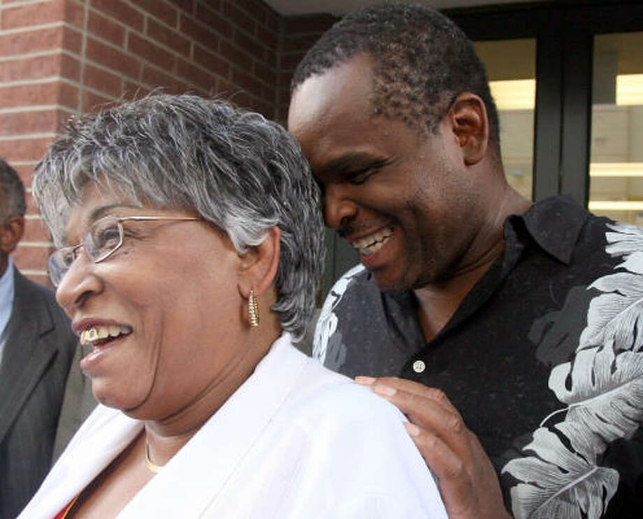 Ronald Gene Taylor smiles as he shares a moment with his mother, Dorothy Henderson, after he was released after 14 years behind bars for a crime he did not commit. Photo: Billy Smith II, Chronicle