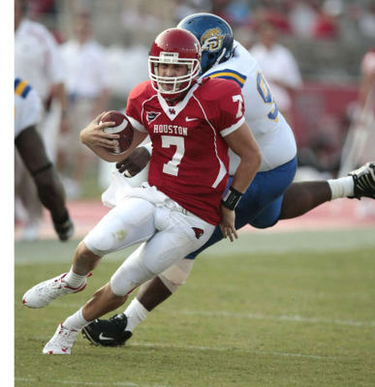 UH quarterback Case Keenum set career highs in yards and touchdowns in three quarters of work Saturday.