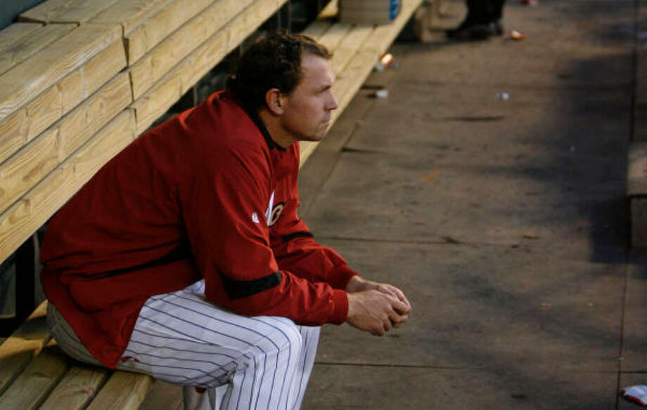 Brian Moehler sits dejected in the dugout after being pulled from the game in the second inning. Photo: Julio Cortez, Chronicle