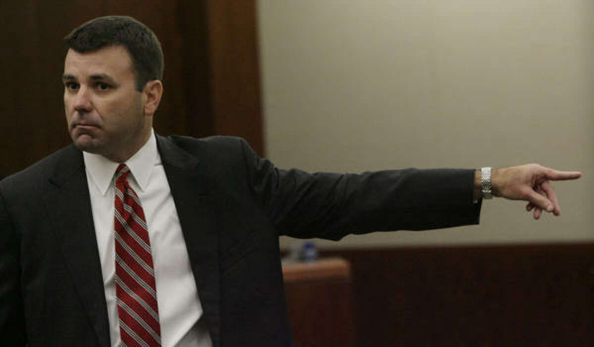 Harris County Assistant District Attorney Rob Freyer points toward Christine Paolilla in his opening arguments Tuesday in the capital murder case against her. Paolilla is accused of helping to kill four of her Clear Lake classmates in a 2003 shooting.