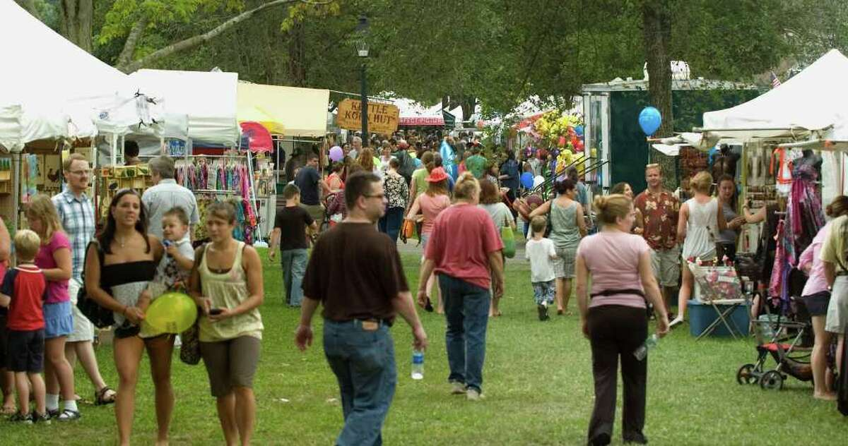 People mingle from stall-to-stall during the 44th Annual New Milford Village Fair Days on Friday, July 29, 2011.