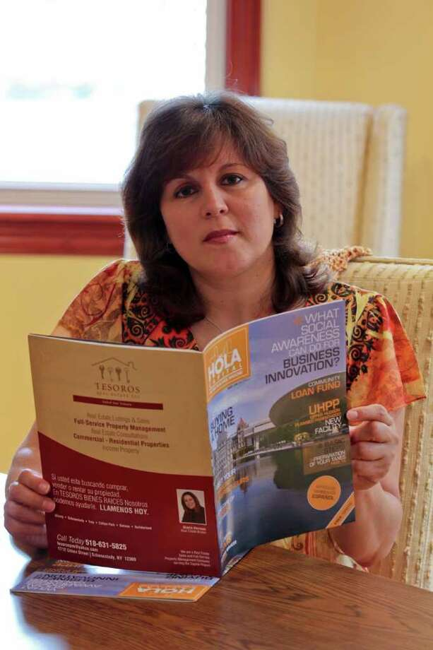 """Gloria Herman, publisher of """"Hola Capital"""" magazine holds a copy of the first issue in her Schenectady office on Friday, July 29, 2011. (Erin Colligan / Special To The Times Union) / 00014088A"""