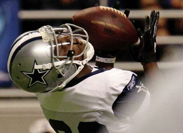 Receiver Dez Bryant makes a catch during the afternoon session of the Dallas Cowboys training camp at the Alamodome on Friday, July 29, 2011. Kin Man Hui/kmhui@express-news.net Photo: KIN MAN HUI, : / SAN ANTONIO EXPRESS-NEWS