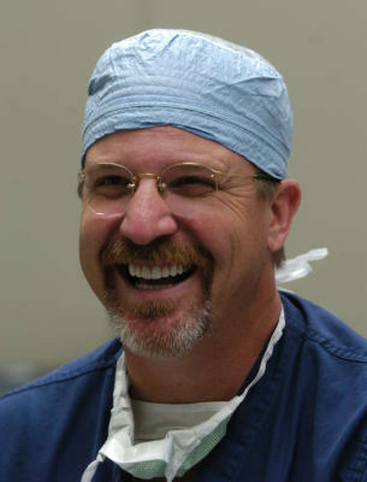 Plastic surgeon Dr. Eugene Alford works with Face to Face, which helps survivors of domestic violence.
